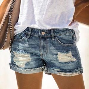 Distressed ripped denim jeans shorts cutoff cuffed